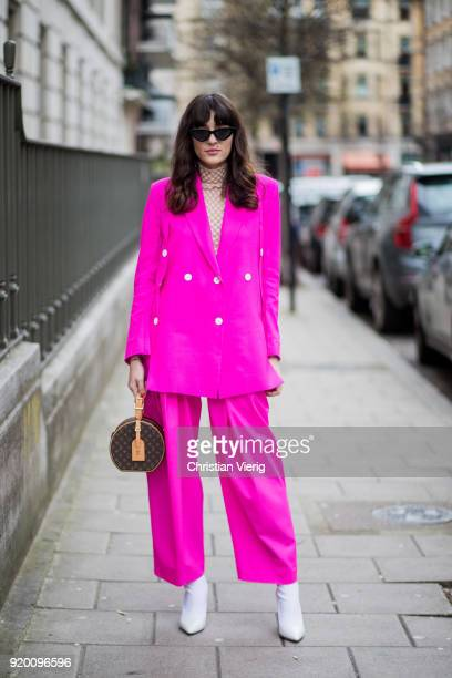 Eleonora Carisi wearing pink suit Louis Vuitton bag seen outside Delpozo during London Fashion Week February 2018 on February 18 2018 in London...