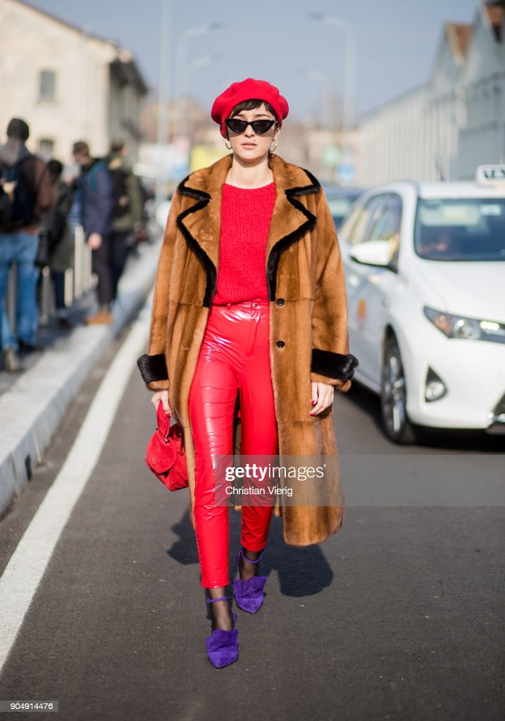 Eleonora Carisi wearing red vinyl pants, red flat cap, red bag, brown fur coat is seen outside DSquared2 during Milan Men's Fashion Week Fall/Winter 2018/19 on January 14, 2018 in Milan, Italy.