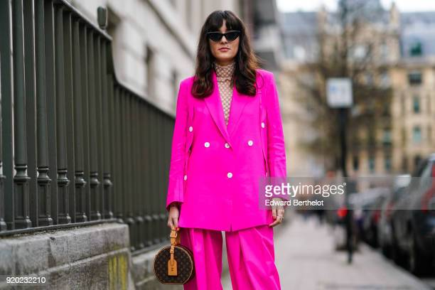 Eleonora Carisi wears a pink blazer jacket suit pants white shoes sunglasses a Vuitton circular bag during London Fashion Week February 2018 on...