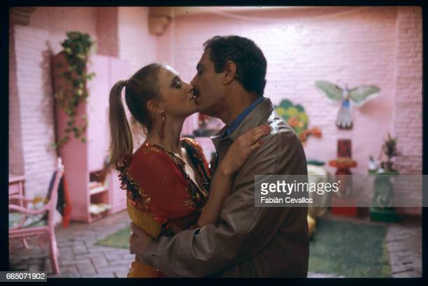 Eleonora Giorgi and Nino Manfredi share a kiss in a scene from the 1981 Italian film, Nudo di Donna. Directed by Alberto Lattuada and Manfredi, who...