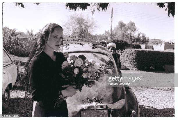 Eleonora Giorgi holds a bouquet of roses in a scene from the 1982 Italian film, Oltre la Porta. Directed by Liliana Cavani, the film is also known in...