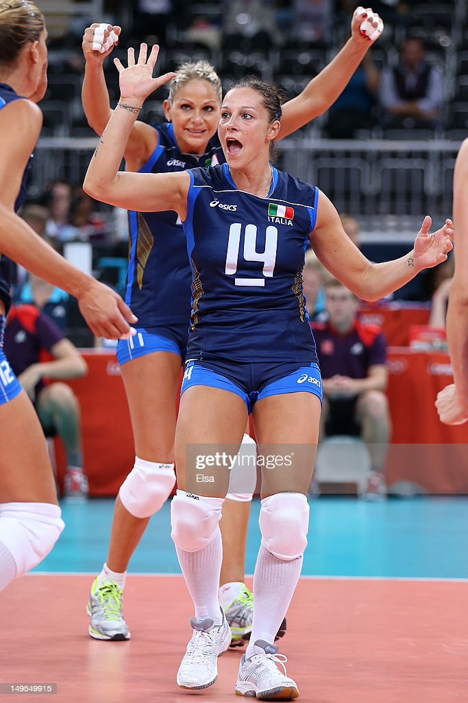 Eleonora Lo Bianco of Italy and team mate Simona Gioli celebrate after winning the Women's Volleyball Preliminary match between Italy and Japan on Day 3 of the London 2012 Olympic Games at Earls Court on July 30, 2012 in London, England.