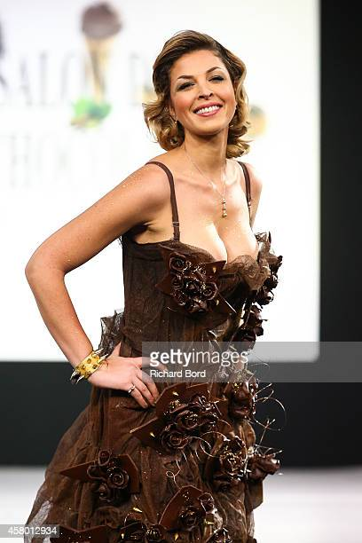 Eleonore Boccara walks the runway and wears a chocolate costume made by designer Christophe Guillarme and chocolate maker Emmanuel Ryon during the...