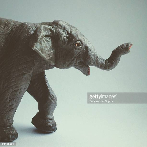 Elephant Toy Against Colored Background