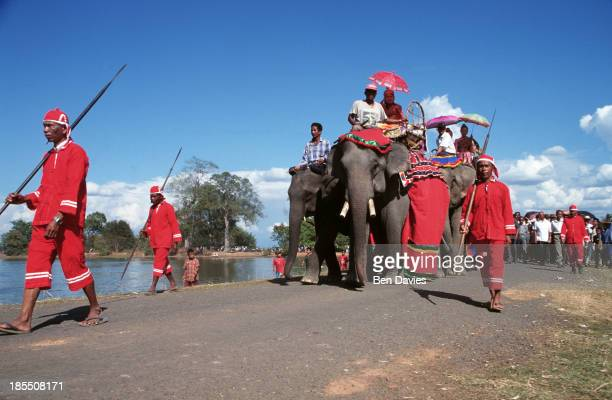 Elephants and their mahout form part of a colourful parade outside the ruins of the Hindu Khmer temple of Wat Phu in Champassak Province Laos during...