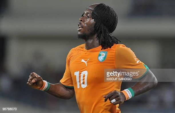 Elephant's Ivory Coast National football team striker Gervais Gervinho celebrates a goal against Black Star of Ghana during their group stage...