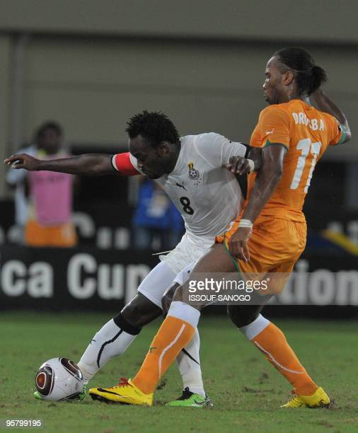 Elephant'sIvory Coast National football team striker and team captain Didier Drogba vies for the ball with Black star of Ghana captain Micheal Essien...