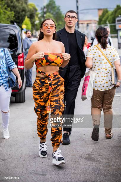 Elettra Miura Lamborghini wearing orange sunglasses cargo top and cargo pants is seen during the 94th Pitti Immagine Uomo at Fortezza Da Basso on...