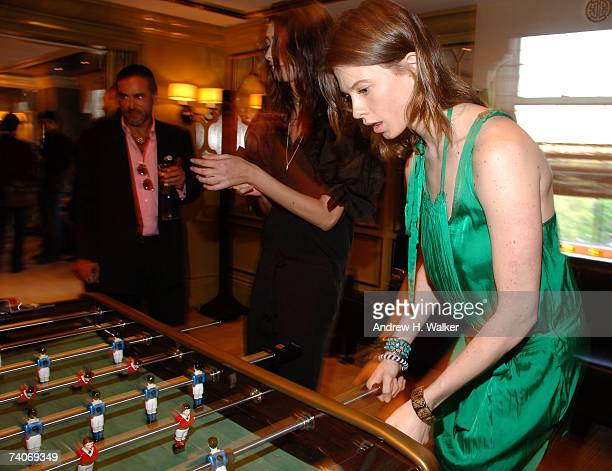 Elettra Rosselini Weiderman plays foosball at a cocktail party for Stella McCartney hosted by Liv Tyler Helena Christensen and Jessica Seinfeld at...
