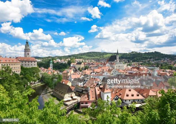 elevated cesky krumlov cityscape with vltava river, castle and romantic sky in czech republic, a unesco heritage site - cesky krumlov castle stock photos and pictures