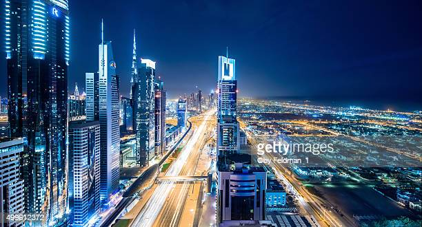 Elevated cityscape of Dubai illuminated at night