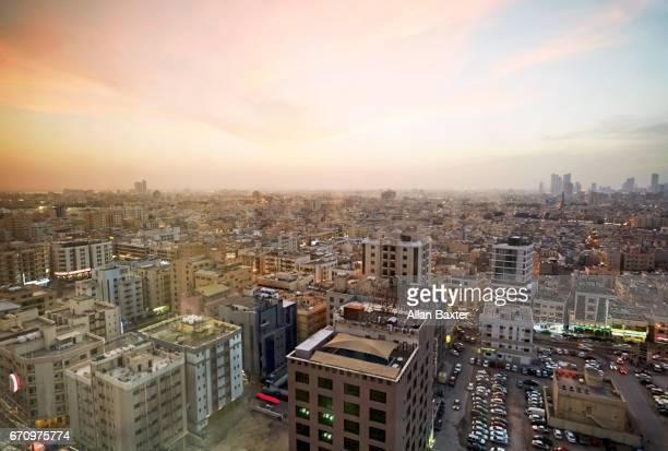 elevated cityscape of manama, bahrain at dusk - manama stock pictures, royalty-free photos & images