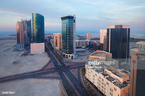 elevated cityscape of manama's seef district - bahrain stock-fotos und bilder