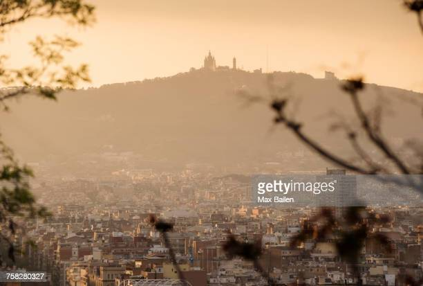 elevated cityscape view to tibidabo from montjuic, barcelona, spain - montjuic stock pictures, royalty-free photos & images