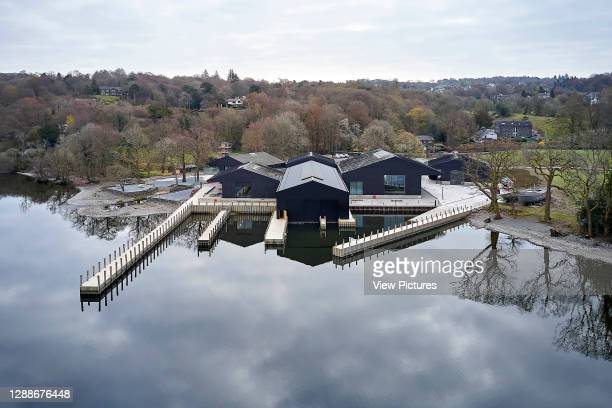 Elevated distant view of exterior from across the lake. Windermere Jetty Museum, Windermere, United Kingdom. Architect: Carmody Groarke, 2019.