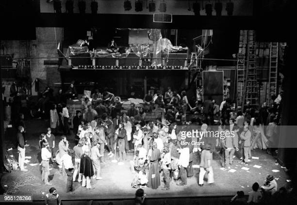 Elevated general view of people on stage at the Filmore East during the venue's takeover by anarchist groups the Family and Up Against the Wall...