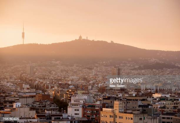 elevated hazy cityscape with distant view of montjuic, barcelona, spain - montjuic stock pictures, royalty-free photos & images
