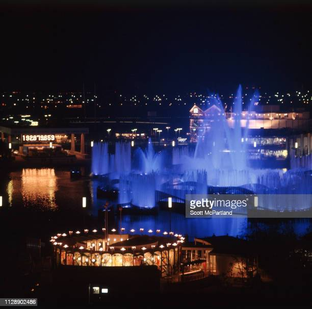 Elevated nighttime view the illuminated Fountain of the Planets at Flushing Meadows Park during the World's Fair in Queens New York New York June...