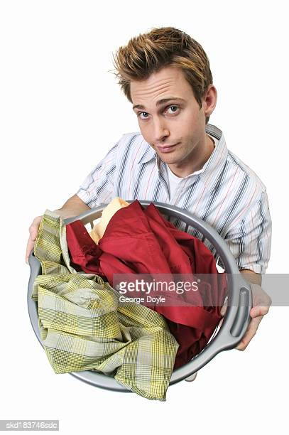 elevated portrait of a man holding a basket of laundry