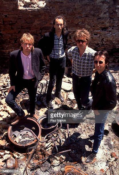 Elevated portrait of American rock group Fire Town as they pose in a junk yard Madison Wisconsin June 2 1987 Pictured are from left Doug Erikson Phil...