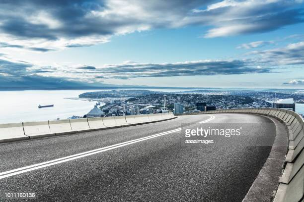 elevated road - curve stock pictures, royalty-free photos & images