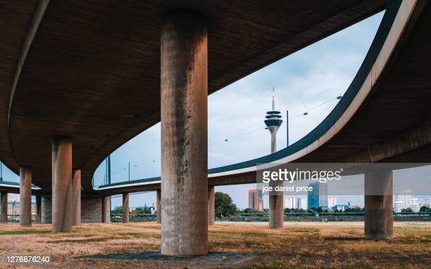 elevated roads, rhine tower, dusseldorf, germany - messe düsseldorf stock pictures, royalty-free photos & images