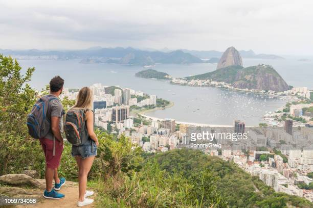 Elevated shot of couple looking at view of the landmark Sugar Loaf Mountain
