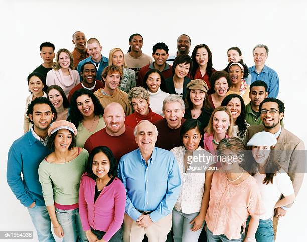 elevated studio shot of a large mixed age, multiethnic crowd of men and women - 大人数 ストックフォトと画像
