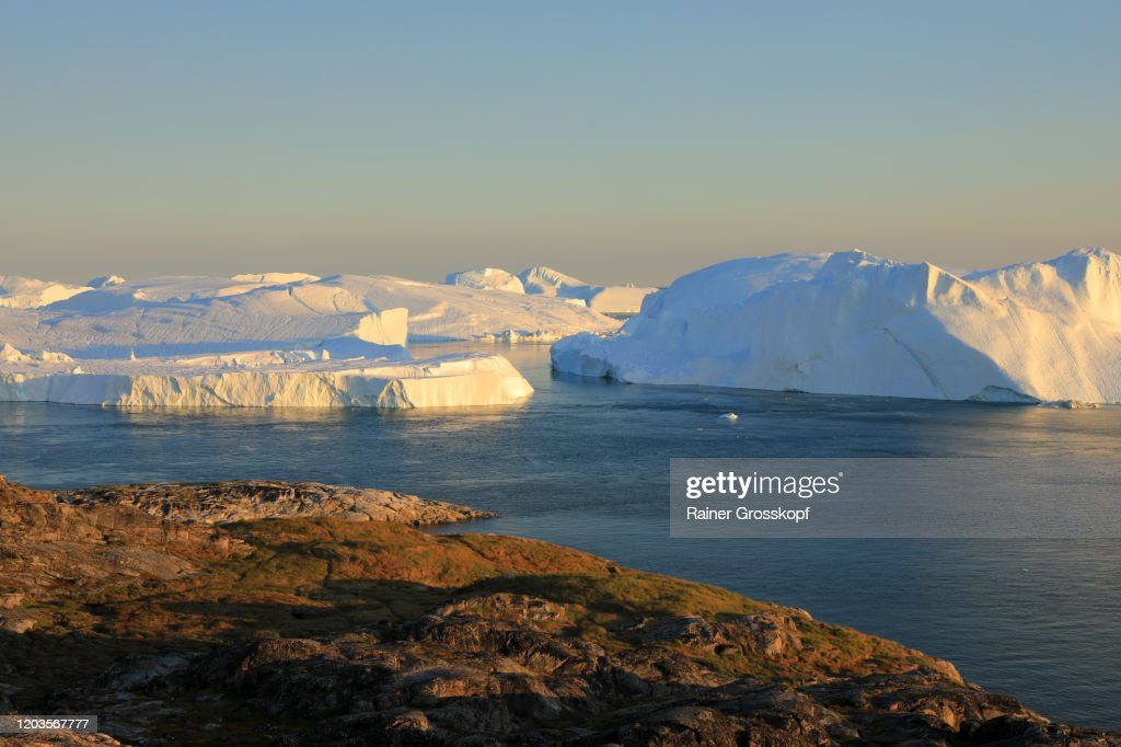 Elevated view at huge icebergs in the Icefjord at late afternoon : Stock Photo