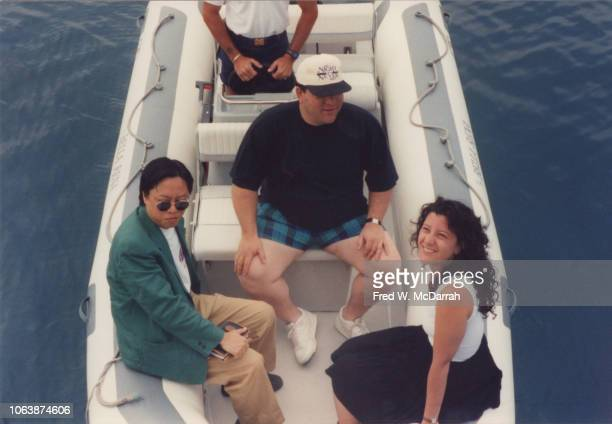 Elevated view from left of Chinese film director producer and distributor Shu Kei American film producer Harvey Weinstein and public relations...