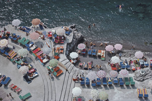 Elevated view looking down on sunbathers and parasols...