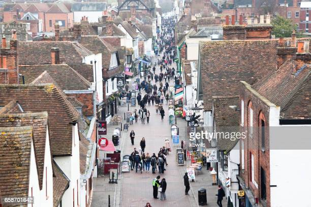elevated view medieval street with tourists and locals in canterbury kent england - high up stock photos and pictures
