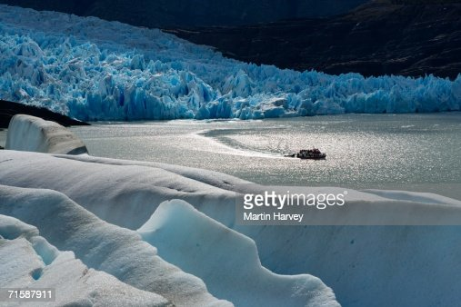 Elevated View of a Boat with tourists viewing Glacier Grey