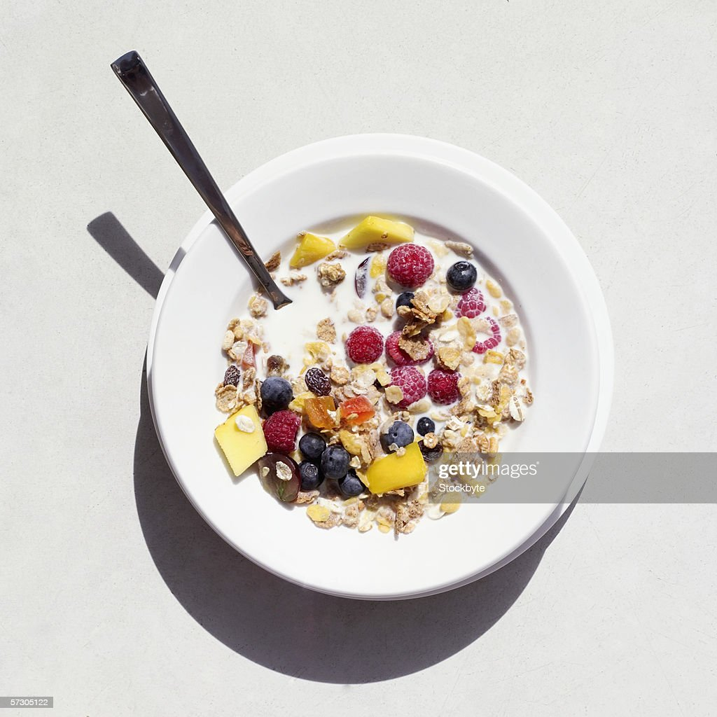 Elevated view of a bowl of fruit and cereal : Stock Photo