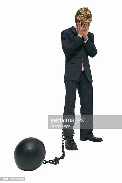 elevated view of a businessman attached to a ball and chain