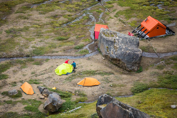 Elevated view of a campsite and emergecy shelter, Akshayuk Pass.