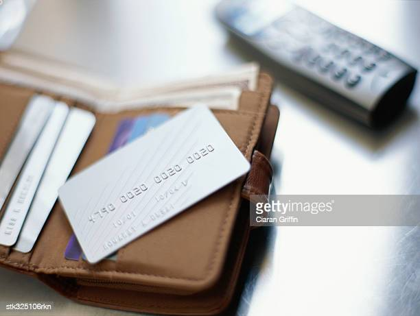 elevated view of a cordless phone and a wallet containing credit cards