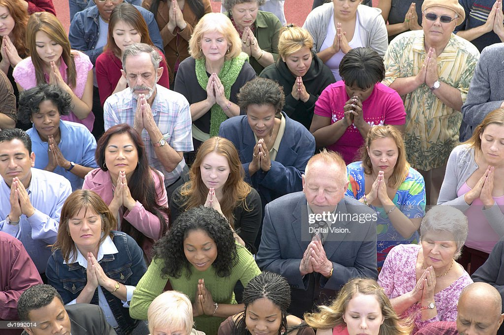 Elevated View of a Crowd of People Praying : Stock Photo