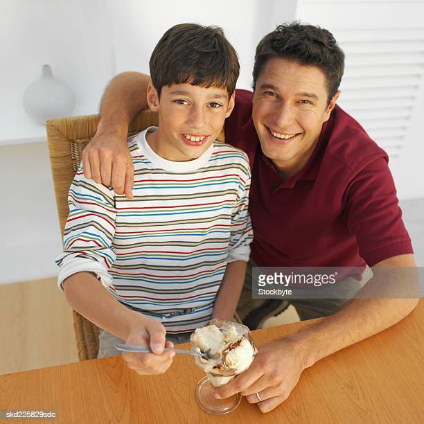 Elevated view of a father and son (11-12) with an ice-cream
