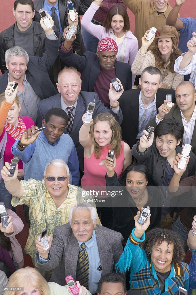 Elevated View of a Large Crowd of People Holding Mobile Phones in the Air : Stock Photo
