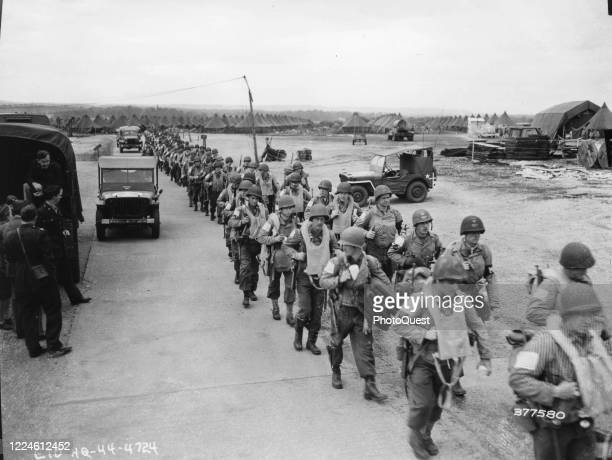 Elevated view of a line of airborne unit troops as they march through AAC Middle Wallop, Hampshire, England, June 6, 1944. They are on their way to...