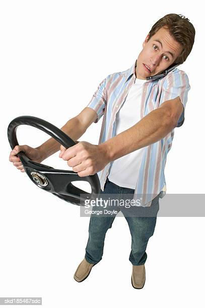 elevated view of a man holding a steering wheel