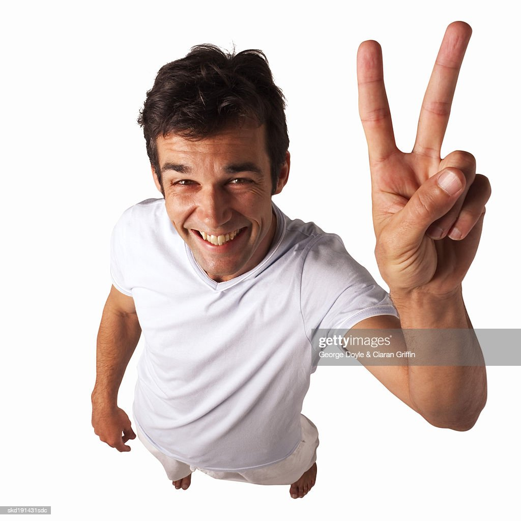 Elevated view of a man holding two fingers up : Stock Photo
