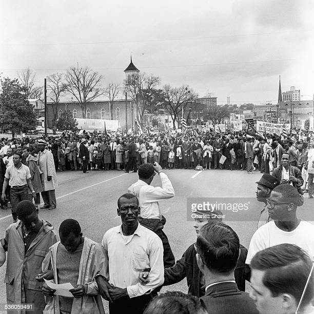Elevated view of a marchers at the culmination of the Selma to Montgomery March, Montgomery, Alabama, March 25, 1965. At far left fore is American...