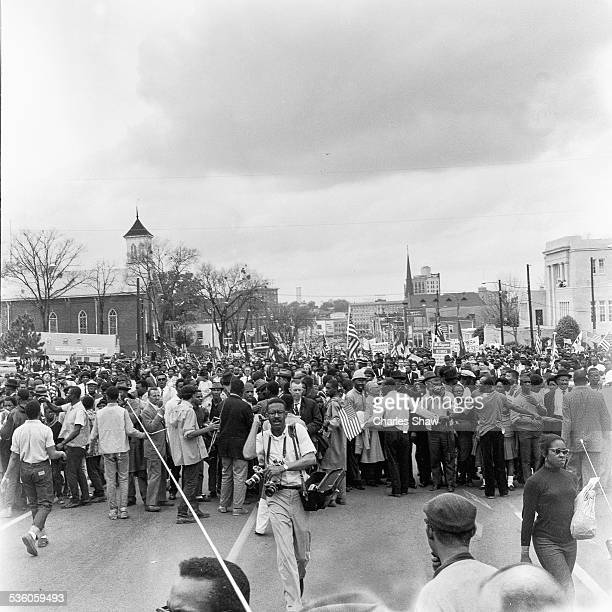 Elevated view of a marchers at the culmination of the Selma to Montgomery March, Montgomery, Alabama, March 25, 1965. Civil Rights activist Andrew...