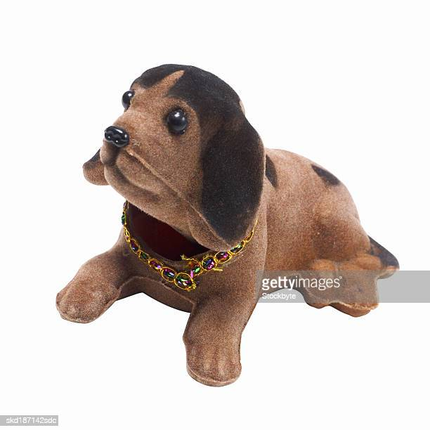 elevated view of a ornament dog - bobble head doll stock photos and pictures