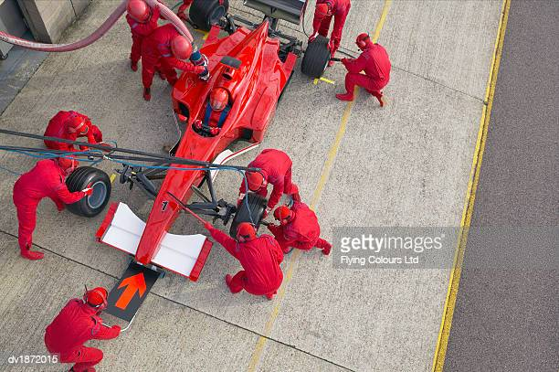 Elevated View of a Pit Stop Mechanics Working on a Formula One Racing Car