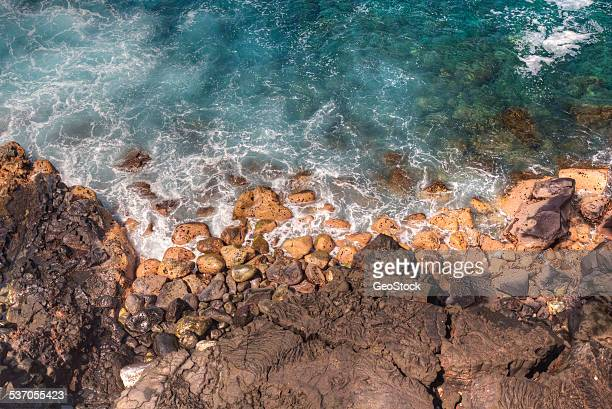 elevated view of a rocky shoreline - calm before the storm stock pictures, royalty-free photos & images
