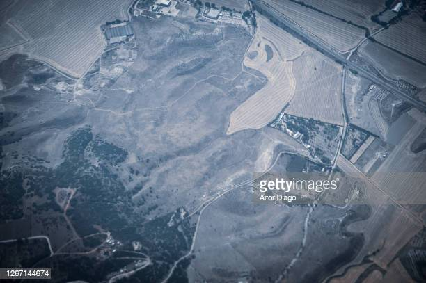 elevated view of a rural area with forest and cultivated fields close to madrid, spain. - monetary policy stock pictures, royalty-free photos & images