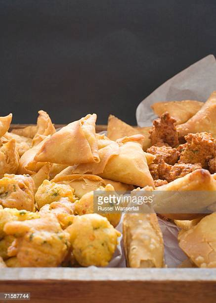 Elevated View of a Tray with a Selection of Samosas and Chilli Bites